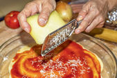Using a grater to grate cheese — Foto Stock