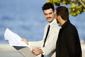 Two men working with paper — Stock Photo