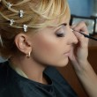 Bride getting make up on — Stock Photo