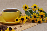 Yellow cup of coffee with Flowers — Stock Photo