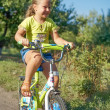 Little girl on bike — Stock Photo
