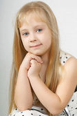 Beautiful young girl gazing intently at you — Stock Photo