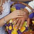 Hand of groom and bride with wedding rings — Stockfoto #33155375