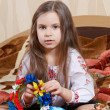 Little girl with a bright wreath — Stock Photo