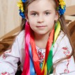 Little girl with a bright wreath — Stock Photo #36517009