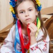 Little girl with a bright wreath — Stock Photo #36517013