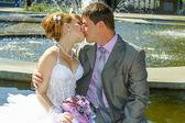 Bride and groom gentle kiss — Stock Photo