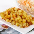 Stock Photo: Fried potato cubes with sour cabbage