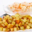 Fried potato cubes with sour cabbage — Stock Photo