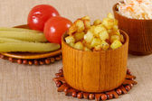 Fried potato cubes with sour cabbage — Stockfoto