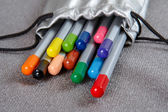 Colored pencils in a silver case — 图库照片