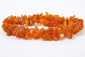 Amber beads  on white background — Stock Photo