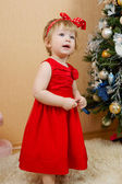 Cute girl in red dress — Stock Photo