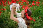 Beautiful  woman plays with a kitten — Stock Photo