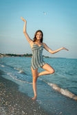 Young cheerful girl on the sea — Stock Photo
