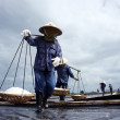 Постер, плакат: Saltworker carry salt with shoulder pole at salina BA RIA VIET NAM FEBRUARY 4