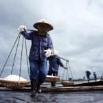 ������, ������: Saltworker carry salt with shoulder pole at salina BA RIA VIET NAM FEBRUARY 4