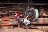 Carpenter pull power-saw at sawmill. QUY NHON, VIET NAM, JUNE 18 — Stock Photo