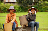 Farmer sit and wait on roadside. DAKLAK, VIET NAM- SEPTEMBER 5 — Stock Photo