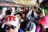 Passenger sit in overcrowded on passenger boat. CA MAU, VIET NAM- JUNE 29, 2013 — Stock Photo