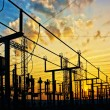 Electricity network at transformer station in sunrise — Stock Photo