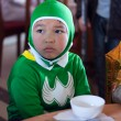 Stock Photo: Boy disguise oneself as batmwith green clothes