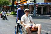 Traveler take a citytour by pedicab — Stock Photo