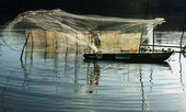 Fisherman cast a net on river — Stock Photo