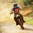 Racer in activity at motorcycle race — Stock Photo