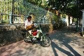 Motorbike taxi sitting on motorbike — Stock Photo