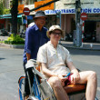 Traveler take a citytour by pedicab — Stock Photo
