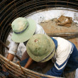 Stock Photo: Workers casting cement culvert for road-works