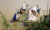 Families of fisherman do fishing on rive — Stock Photo