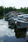 Residential area on river with corrugated iron houses — Stock Photo