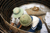 Workers casting cement culvert for road-works — Stock Photo