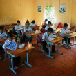 Foto Stock: Primary pupil in school time