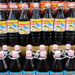 Fish sauce bottles in retail store — Stock Photo