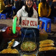 Stock Photo: Funny of Vietnamese street food vendor at night outdoor market