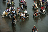 Crowd of people ride motorcycle in rush hour — Stock Photo