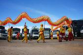 Team of people perform dragon dance — Stock Photo