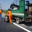Постер, плакат: Team of traffice worker work on road