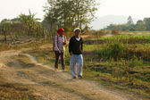 Couple walking on path at countryside — Stock Photo