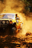 Racer at terrain racing car competition — Stock Photo