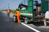 Team of traffice worker work on road — 图库照片