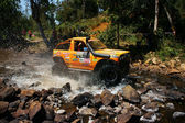 Racer off road at terrain racing car competition — Stock Photo