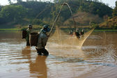People catch fish by lift net on ditch — Stock Photo