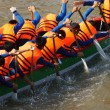 Постер, плакат: Team building activity rowing dragon boat racing
