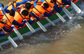 Team building activity,  rowing dragon boat race — Stock Photo