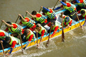 People in activity, rowing dragon boat in racing — Stock Photo