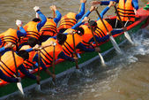 Team building activity,  rowing dragon boat racing — Stock Photo